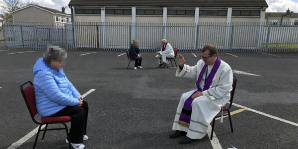 Covid-19: Dublin priest hears confessions in church car park